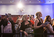 """Crowds cheer on models and their hair sculptures during """"Hair Affair: The Art of Hair"""" at Madison Museum of Contemporary Art in Madison, WI on Thursday, April 25, 2019. The sixth biennial brought an array of designers and stylists from across Wisconsin to create under the theme of """"Zodiac."""""""