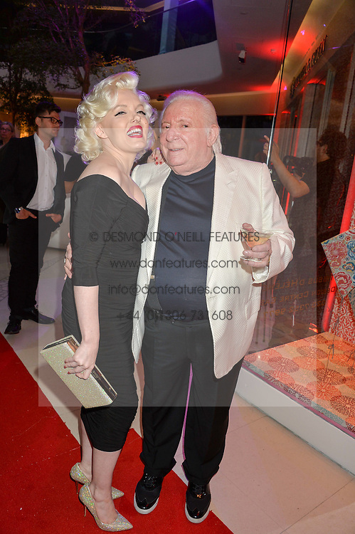 Marilyn Monroe lookalike SUZI KENNEDY and  TERENCE COLE at a private view of Marilyn - The Legacy of a Legend held at the Design Centre, Chelsea Harbour, London on 25th May 2016.