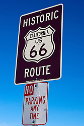 Historic Route 66 sign on top of a No Parking Any Time sign, Victorville, California, United States of America