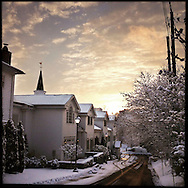 NEWTOWN, CT-10 December 2013- The sun sets in Newtown on a snowy December afternoon. Residents are hoping for a return to life before the tragedy. The life the small New England town knew before the Sandy Hook Elementary School shooting of December 14, 2012. One year later, townspeople don't want memorials…they don't want teddy bears, they don't want the world's attention…they want their town back, stolen from them by an unspeakable act.    (Photo by Robert Falcetti)