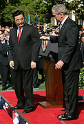 U.S. President George W. Bush (R) grabs Chinese President Hu Jintaoís jacket to keep him from walking down the stairs during an arrival ceremony on the South Lawn of the White House in Washington, DC Thursday 20 April 2006. The two Presidents will hold talks today that are expected to focus on trade, human rights and the diplomatic standoff over Iran's nuclear program.