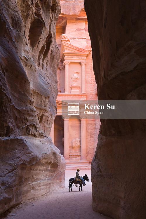 Tourists in Al-Siq leading to Facade of Treasury (Al Khazneh), Petra, Jordan (UNESCO World Heritage site)