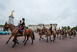 © London News Pictures. 14/07/2015.  King's Troop Royal Horse Artillery make their way along The Mall infant of Buckingham palace. King's Troop Royal Horse Artillery took over from the Household Cavalry to provide the Queen's Life Guard at Horse Guards at the beginning of July.  More usually associated with the ceremonial gun salutes and musical rides with their 13lb guns, they took on the role of both mounted and dismounted guard at the entrance of Horse Guards..  Photo credit: Sergeant Rupert Frere/LNP