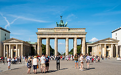 Many tourists standing in front of Brandenburg Gate in Mitte district of Berlin Germany