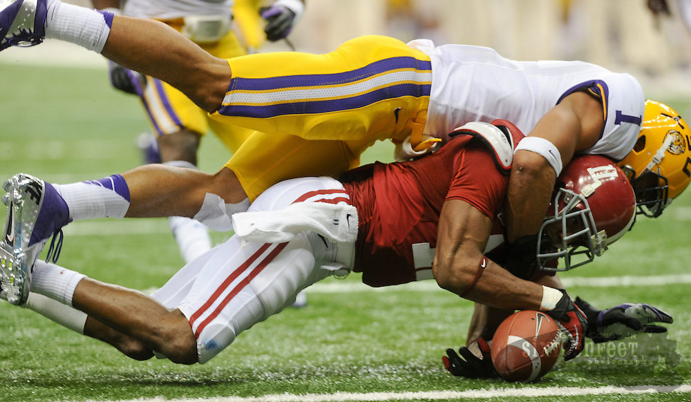 Daily Photo by Gary Cosby Jr.    ..Eric Reid breaks up a pass on the goal line intended for Brandon Gibson during the second half of the BCS National Championship Game between Alabama and LSU in the Superdome Monday night...................................