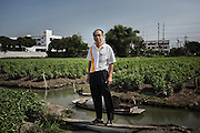 April 2013 - Vichain Kongsub, the elected chief of his village, poses for a portrait in the fields of Sai Noi, north east Bangkok. He and the local residents' committee quickly improvised a plan when it became clear the flood would reach their area. © Giorgio Taraschi for The Rockefeller Foundation/Next City