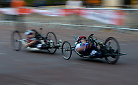 In-camera slow shutter speed pan used in this photo of Competitors race along The Mall in The Prudential RideLondon Handcycle Grand Prix. Saturday 28th July 2018<br /> <br /> Photo: Ian Walton for Prudential RideLondon<br /> <br /> Prudential RideLondon is the world's greatest festival of cycling, involving 100,000+ cyclists - from Olympic champions to a free family fun ride - riding in events over closed roads in London and Surrey over the weekend of 28th and 29th July 2018<br /> <br /> See www.PrudentialRideLondon.co.uk for more.<br /> <br /> For further information: media@londonmarathonevents.co.uk