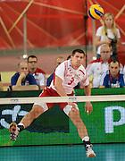LODZ, POLAND - SEPTEMBER 16: Dawid Konarski of Poland serves the ball during the FIVB World Championships match between Poland and Brazil on September 16, 2014 in Lodz, Poland. (Photo by Piotr Hawalej)