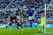 Fabian Schar (#5) of Newcastle United and Lucas Digne (#12) of Everton contest the ball in the air during the Premier League match between Newcastle United and Everton at St. James's Park, Newcastle, England on 9 March 2019.
