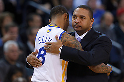 Jan 25, 2012; Oakland, CA, USA; Golden State Warriors head coach Mark Jackson (right) hugs shooting guard Monta Ellis (8) before the game against the Portland Trail Blazers at Oracle Arena. Golden State defeated Portland 101-93. Mandatory Credit: Jason O. Watson-US PRESSWIRE