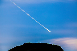 Plane trail over Edinburgh.