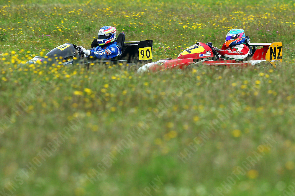 Karl Wilson, NZ, and Ryan Urban, 90, race in the International Superkarts class during the 2012 Superkart National Champs and Grand Prix at Manfeild in Feilding, New Zealand on Saturday, 7 January 2011. Credit: Hagen Hopkins.