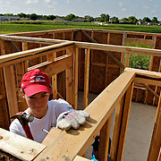 Incoming Rice freshmen Elena White, 19, of Houston, Tx help build homes with Habitat for Humanity as part of Rice University initiative to help its new students connect with Houston communities on Monday, July 28, 2008.