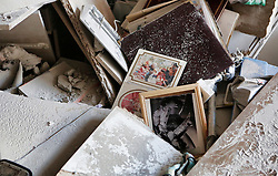 © Licensed to London News Pictures 20/11/2012.  Be'er Sheva, Israel.   A family photograph lies amongst the rubble of a home hit by a rocket in the Southern Israeli city of Be'er Sheva. Damage to a family home in the city of Be'er Sheva.  The house was hit by a rocket this morning.  The family managed to escape into a safe room before the attack took place.  The rocket strike came after 16 missiles were fired at the city from Gaza.  Photo credit : Alison Baskerville/LNP