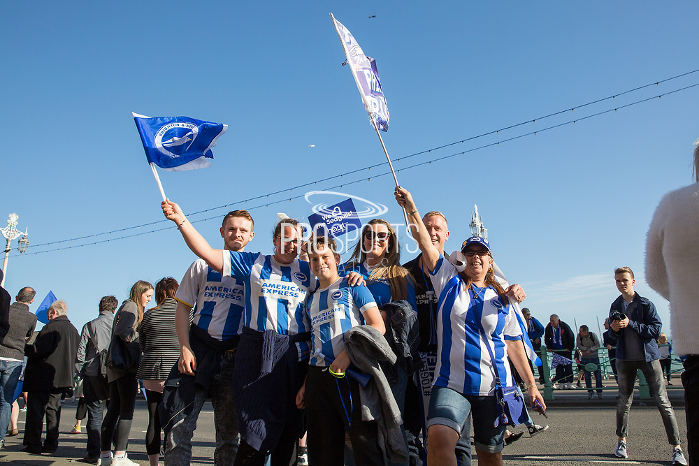 Fans with flags during the Brighton & Hove Albion Football Club Promotion Parade at Brighton Seafront, Brighton, East Sussex. United Kingdom on 14 May 2017. Photo by Ellie Hoad.