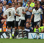Tom Cairney getting congratulated by team mates after scoring the equaliser during the Sky Bet Championship match between Fulham and Brighton and Hove Albion at Craven Cottage, London, England on 15 August 2015. Photo by Matthew Redman.