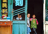 China, Pingyao, 2008. Everyone enjoys a laugh at this locksmith's shop in the ancient city of Pingyao, one of China's many UNESCO World Heritage sites..