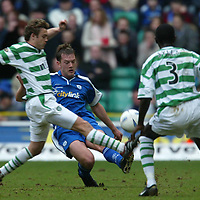 Celtic v St Johnstone..  23.02.03<br />Ian Maxwell closed down by David Fernadez and Momo Sylla<br /><br />Pic by Graeme Hart<br />Copyright Perthshire Picture Agency<br />Tel: 01738 623350 / 07990 594431