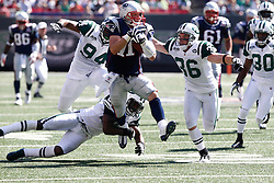 Sept 20, 2009; East Rutherford, NJ, USA;  New England Patriots wide receiver Julian Edelman (11) is chased by New York Jets safety Jim Leonhard (36) after making a catch during the first half at Giants Stadium.