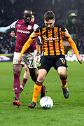 Hull City midfielder Jon Toral (11) on the ball, closely watched by Aston Villa midfielder Albert Adomah (37)  during the EFL Sky Bet Championship match between Hull City and Aston Villa at the KCOM Stadium, Kingston upon Hull, England on 31 March 2018. Picture by Mick Atkins.