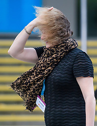 © Licensed to London News Pictures. 02/10/2017. Manchester, UK. A delicates hair is blown about as she battles with strong wind on the second day of the Conservative Party Conference. The four day event is expected to focus heavily on Brexit, with the British prime minister hoping to dampen rumours of a leadership challenge. Photo credit: Ben Cawthra/LNP