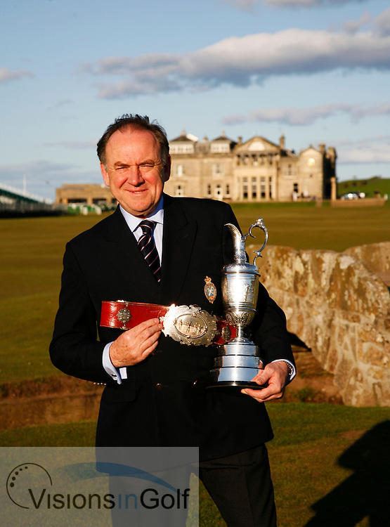 Peter Dawson, Chief Executive of the R&amp;A with the Open Championship Trophy and the original Champions Belt by the Swilken Bridge at St. Andrews.<br /> Picture Credit: Mark Newcombe / visionsingolf.com