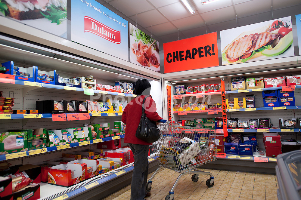 A woman shopping for bargain foods in Lidl discount supermarket UK