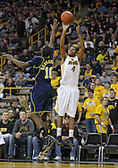 February 19 2011: Iowa Hawkeyes guard/forward Roy Devyn Marble (4) puts up a shot over Michigan Wolverines guard Tim Hardaway Jr. (10) during the first half of an NCAA college basketball game at Carver-Hawkeye Arena in Iowa City, Iowa on February 19, 2011. Michigan defeated Iowa 75-72 in overtime.