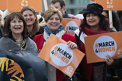 © Licensed to London News Pictures. 05/03/2017. LONDON, UK.  Emily Thornberry MP with feminist activists during the March4Women, organised by CARE International to mark International Women's Day. The Women's Day March begins at The Scoop near City Hall, before proceeding over Tower Bridge and finishing at the Tower of London. Photo credit: Vickie Flores/LNP