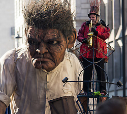 "London, March 13th 2016. The annual St Patrick's Day Parade takes place in the Capital with various groups from the Irish community as well as contingents from other ethnicities taking part in a procession from Green Park to Trafalgar Square.  PICTURED: A giant ""Crom"" from the Macnas street theatre company in Co Galway dwarfs one of the performers. ©Paul Davey<br /> FOR LICENCING CONTACT: Paul Davey +44 (0) 7966 016 296 paul@pauldaveycreative.co.uk"
