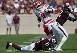 Louisiana-Lafayette running back Trey Ragas (9) is tackled by Texas A&M defensive back Larry Pryor (11) during the first quarter of an NCAA college football game Saturday, Sept. 16, 2017, in College Station, Texas. (AP Photo/Sam Craft)