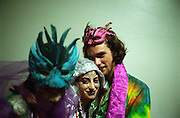 Copyright ©Ê2004 Jeremy Hogan - All Rights Reserved..Three attendees of the last Grateful Dead Mardi Gras show pose for a picture in a back hall of the Oakland Colesium during spring 1995. ..dead heads, deadheads, mardi gras, concert, hipsters, hippies, hip, counterculture, tie dye, tie dyed, masks, hugging, friendship, dead head,