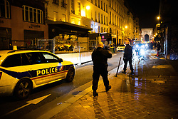 Police officers control the closure of a bar. The street of rue du faubourg saint denis at midnight with bar closing in Paris, on March 14, 2020. France on March 14, 2020 drastically stepped up its measures against the spread of the coronavirus, announcing the closure of all non-essential public places including restaurants, bars and cafes from midnight. Photo by Raphael Lafargue/ABACAPRESS.COM