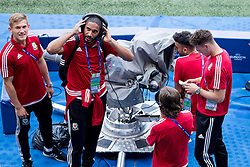 LYON, FRANCE - Tuesday, July 5, 2016: Wales' captain Ashley Williams listens to a TV cameraman's headphones as Neil Taylor tries out the camera controls after a training session ahead of their UEFA Euro 2016 Championship Semi-Final match against Portugal at the Stade de Lyon. George Williams (Pic by Paul Greenwood/Propaganda)