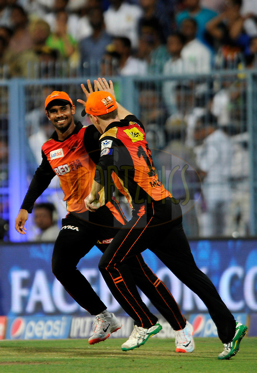 Eoin Morgan of Sunrisers Hyderabad celebrates after taking a catch to get the wicket of Andre Russell of Kolkata Knight Riders during match 38 of the Pepsi IPL 2015 (Indian Premier League) between The Kolkata Knight Riders and The Sunrisers Hyderabad held at Eden Gardens Stadium in Kolkata, India on the 4th May 2015.<br /> <br /> Photo by:  Pal Pillai / SPORTZPICS / IPL