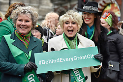 © Licensed to London News Pictures. 18/03/2018. LONDON, UK. (L to R) Imelda Staunton, actress, and Gloria Hunniford, presenter, act as Grand Marshalls for the parade. The 16th annual London St. Patrick's Day parade takes place through central London.  Tens of thousands of people enjoy the parade as well as festivities in Trafalgar Square.  The event showcases the best of Irish food, music, song, dance, culture and arts and this year, celebrates the achievements and successes of London's Irish women as part of the Mayor of London's #BehindEveryGreatCity campaign.   Photo credit: Stephen Chung/LNP