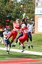 05 November 2011:  Trying to catch a Hail Mary pass from Matt Brown as time expires the first half are James O'Shaughnessy, Kieron James, and Lechein Neblett during an NCAA football game between the Western Illinois Leathernecks and the Illinois State Redbirds at Hancock Stadium in Normal IL