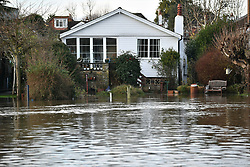 © Licensed to London News Pictures. 22/12/2019. Thanmes Ditton, UK. Flood water surrounds residential properties in Thames Ditton, Surrey. Further weather warnings are in place following flooding and high winds in parts of the UK . Photo credit: Ben Cawthra/LNP