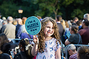 "New York, NY – 16 September 2019. Massachusetts Senator and Democratic Presidential candidate Elizabeth Warren drew a large and enthusiastic crowd at a speech for her increasingly popular 2020 presidential campaign in New York's Washington Square. A young girl holds up a fan that reads ""I'm a Warren Fan."""