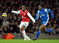 Photo: Ed Godden.<br /> Arsenal v Portsmouth. The Barclays Premiership. 16/12/2006. Arsenal's Johan Djourou (L), is followed by Kanu.