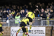 Harrogate Town defender Ryan Fallowfield (2) goes over the top when celebrating during the Vanarama National League match between FC Halifax Town and Dover Athletic at the Shay, Halifax, United Kingdom on 17 November 2018.