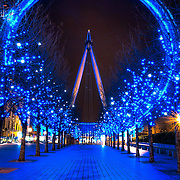 The London Eye lit up a stunning blue on a cold winter night.