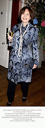 Social figure MRS MARK LITTMAN, at a party in London on 10th April 2003. PIW 14