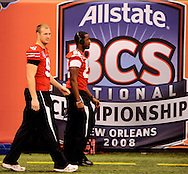 Ohio State's Brett Daly, left, and Rory Nicol walk past a BCS Championship logo during Media Day at the Superdome in New Orleans, Jan. 5, 2007.