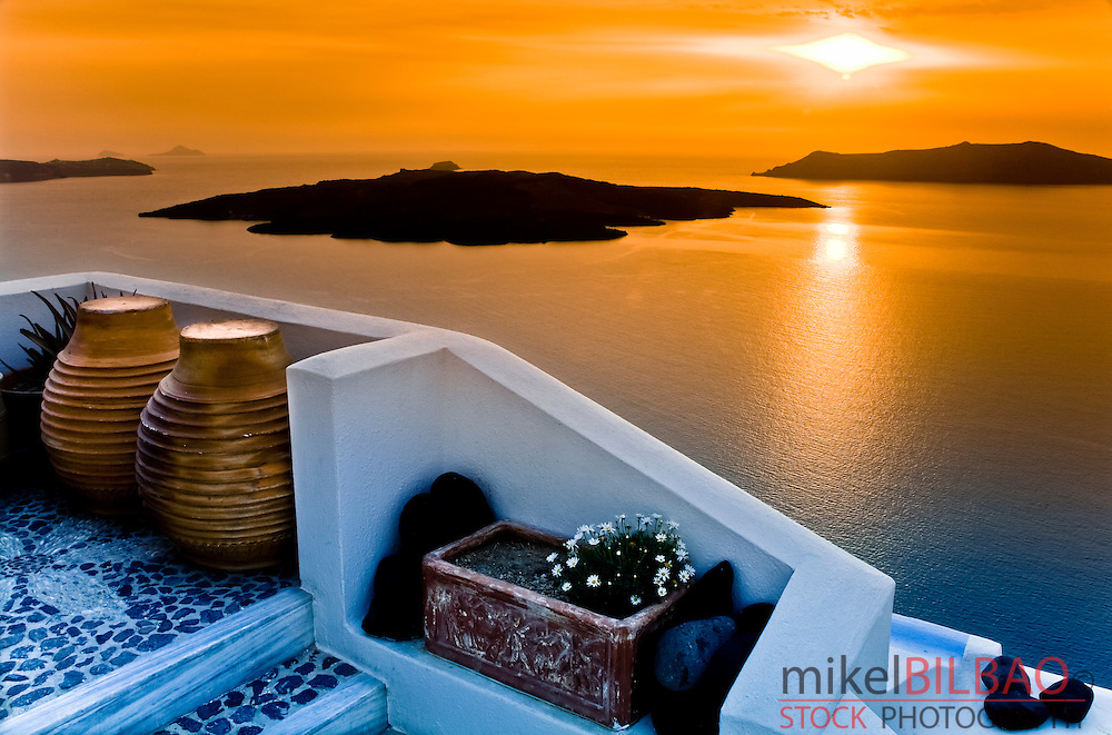 Caldera view from Fira village at sunset.<br /> Santorini island, Greece, Europe