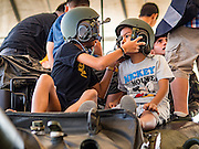 "14 JANUARY 2017 - BANGKOK, THAILAND: Children wearing tanker's helmet sit on top of a Royal Thai Army M60 A3 Main Battle Tank during Children's Day activities at the King's Guard, 2nd Cavalry Division base in Bangkok. Thailand National Children's Day is celebrated on the second Saturday in January. Known as ""Wan Dek"" in Thailand, Children's Day is celebrated to give children the opportunity to have fun and to create awareness about their significant role towards the development of the country. Many government offices open to tours and military bases hold special children's day events. It was established as a holiday in 1955.       PHOTO BY JACK KURTZ"