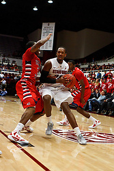 Nov 14, 2011; Stanford CA, USA;  Stanford Cardinal guard Jarrett Mann (22) is defended by Fresno State Bulldogs guard Kevin Olekaibe (3) during the first half of a preseason NIT game at Maples Pavilion. Mandatory Credit: Jason O. Watson-US PRESSWIRE