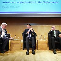 Nederland, Amsterdam , 15 mei 2014. <br /> Minister-president Rutte opende donderdag 15 mei de Nederlandse vestiging van de Europese Investeringsbank (EIB) in Amsterdam. <br /> Pim van Ballekom, vice-president (links naast de premier)  en rechts Werner Hoyer, de president van de EIB. Helemaal links Wientjes De EIB is het financieringsinstituut van de Europese Unie.<br /> De 28 lidstaten zijn aandeelhouder. De bank is opgericht in 1958 bij het Verdrag van Rome en heeft als doel projecten te financieren die zijn gericht op de versterking van de Europese economie.<br /> Prime Minister Rutte (m) opened Thursday, May 15th, the Dutch branch of the European Investment Bank (EIB) in Amsterdam. Left Pim van Ballekom, Vice-President of the EIB and right Werner Hoyer, president.<br /> <br /> The EIB is the financing institution of the European Union.