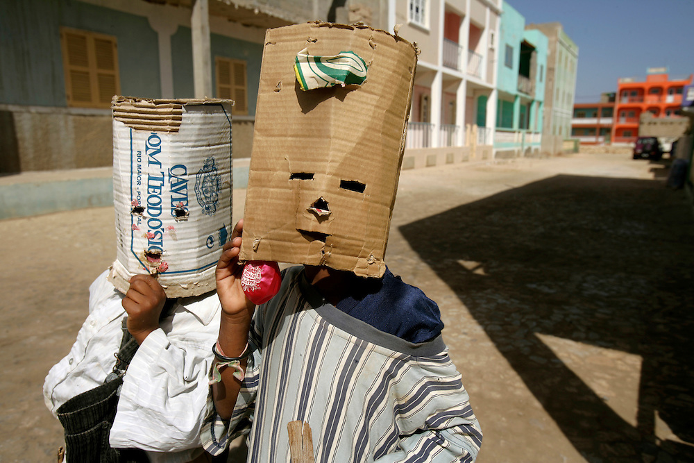 Children on Vila do Maio (Maio's Village)streets, playing with improvised Carnival masks.