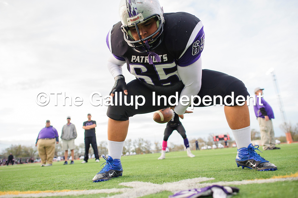 101714  Adron Gardner/Independent<br /> <br /> Miyamura Patriot Terrance King (65) snaps the ball during a warmup before facing off with the Piedra Vista Panthers at Public School Stadium Friday.